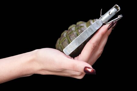 hand grenade in girl hand on black background Imagens