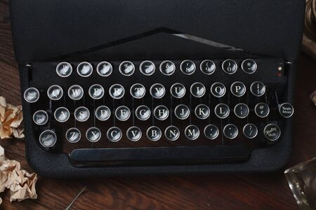 Writing a crime fiction story - old retro vintage typewriter on wooden table 스톡 콘텐츠
