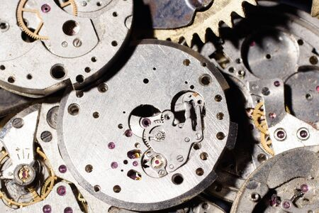 Broken movement of an old pocket watches background 写真素材