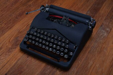 Old retro vintage typewriter on wooden table