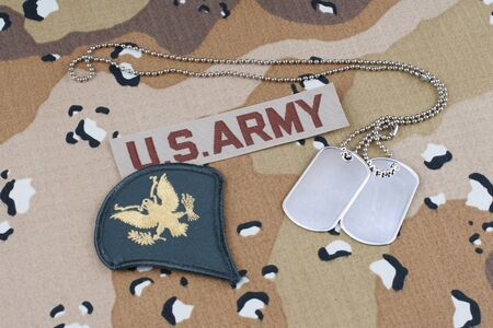 US ARMY desert pattern battle dress uniform with dog tags and rank patch