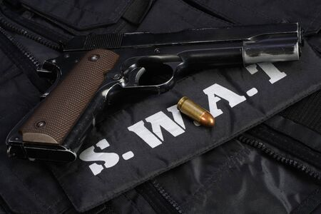 SWAT (Special weapons and tactics team) weapon ammunitions and equipment on black uniform background 版權商用圖片
