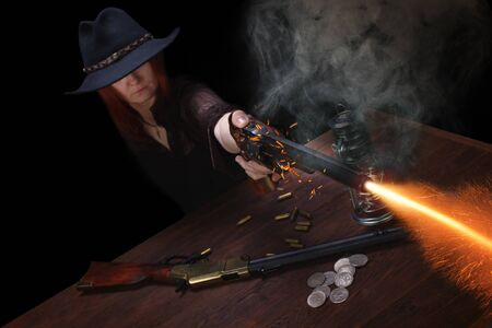 wild west girl shooting from revolver gun at the table with ammunition and silver coins on black background