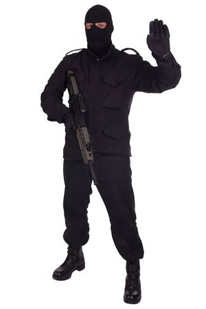man in black uniform and mask with assault rifle isolated on white background