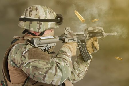 A soldier shooting from assault rifle Imagens