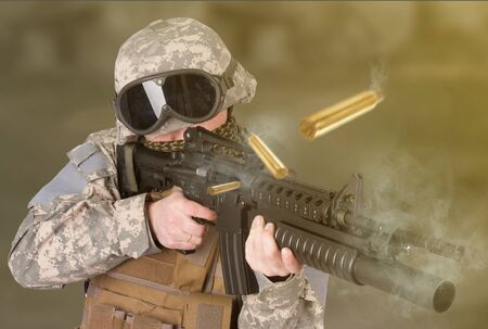 US ARMY soldier shooting from assault rifle