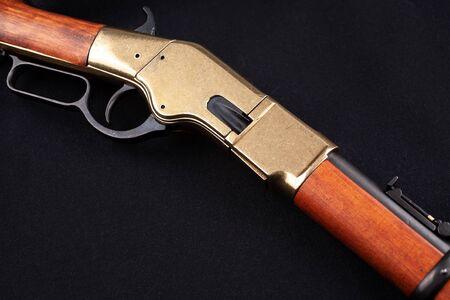 Wild west gun on black canvas Stock Photo