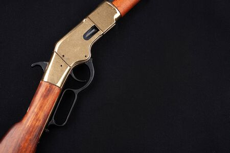 Wild west gun on black canvas Stock Photo