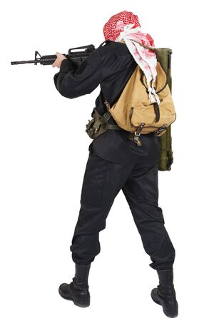 guerillas in black uniform with keffiyeh with assault rifle isolated on white