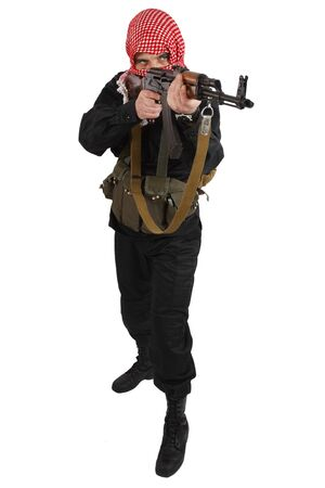 guerillas in black uniform with keffiyeh with AK 47 assault rifle isolated on white