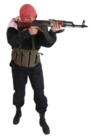 guerillas in black uniform with keffiyeh with AK 47 assault rifle isolated on white Standard-Bild