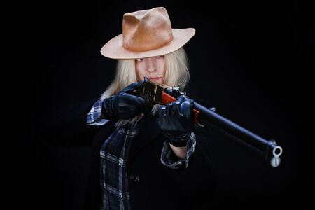 wild west blonde girl with rifle on black background