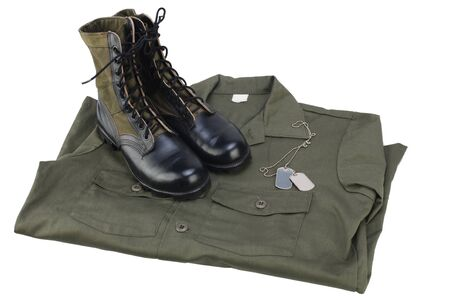 New brand US army utility uniforms shirt and jungle boots with dog tags isolated on white background