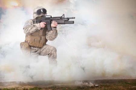 US ARMY soldier firing M4 carbine