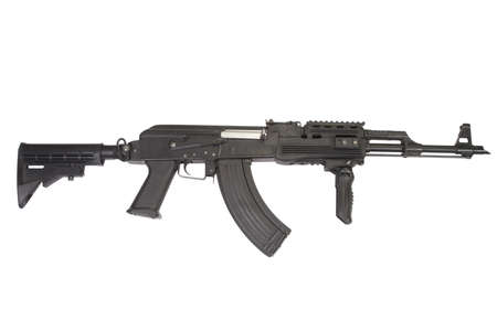 Rare first model AK - 47 assault rifle with modern tactical accessories isolated on white