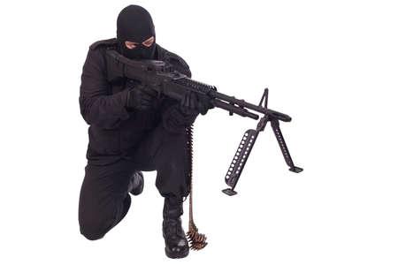 militant in black uniform firing machine gun isolated on white background