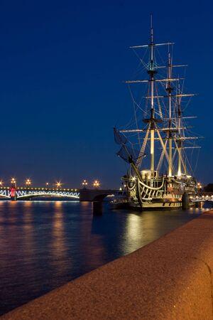 Three-masted sailing ship in Saint Petersburg embankment photo
