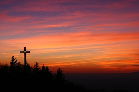 landscape with the cross at sunset seen from the sanctuary of castelmonte, udine, italy photo