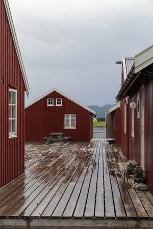 fishing huts: Traditional red fishing huts