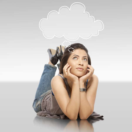 Lady laying on floor with thought bubble Stock Photo - 19636713