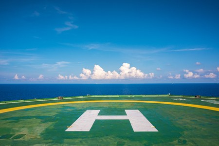 helipad: Empty oil rig helipad with few cloud and blue sky in Gulf of Thailand Stock Photo
