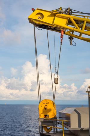 hoist: Yellow oil rig crane hoist at storage Stock Photo