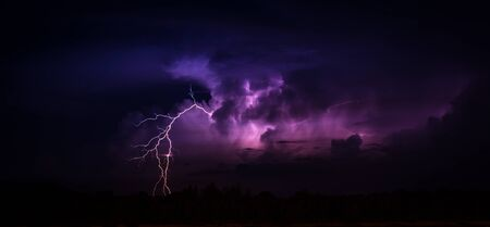 Lightning in the big cumulonimbus cloud
