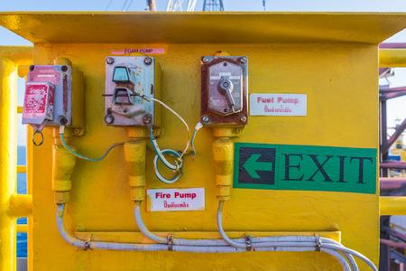 helipad: Foam, water and fuel valve panel on jack up oil rig helipad Stock Photo