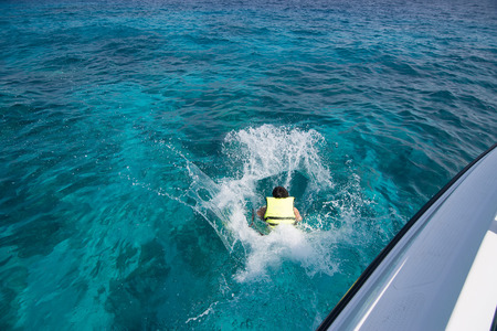 speed boat: Man jumping from speed boat to the sea at Tachai island