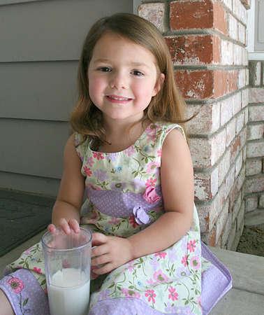 A healthy little girl sporting a milk mustache Reklamní fotografie