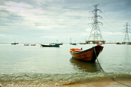 fishing boat with power plant background photo