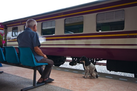 man and dog in train station