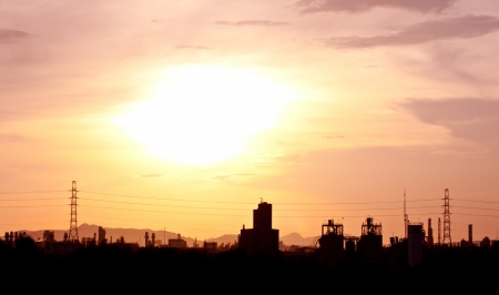 manufacturing plants at sunset photo