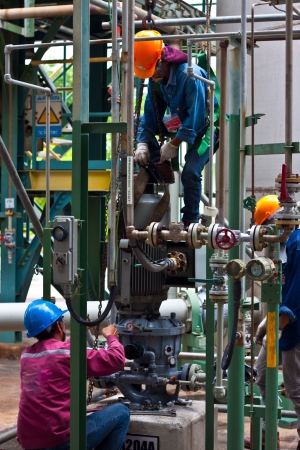 workers are repairing sundyne  pump in petrochemical plant Editorial