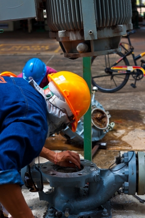 workers are repairing sundyne  pump in petrochemical plant Stock Photo