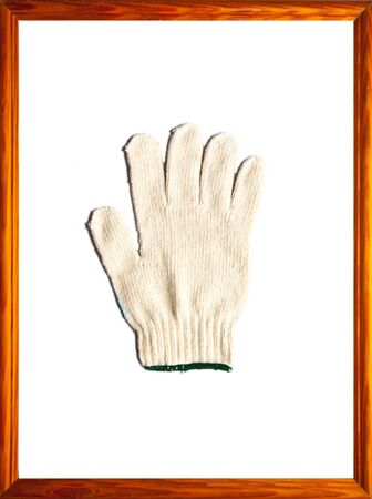 gloves in wood picture frame, isolated on white background  photo