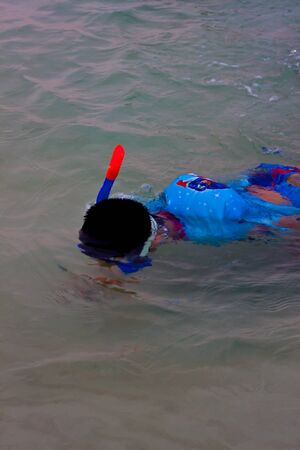 Couple snorkeling in samed waters photo