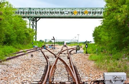ballast: railway Workers repairing railway on hot summer day