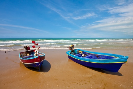 fishing boats on the beach photo