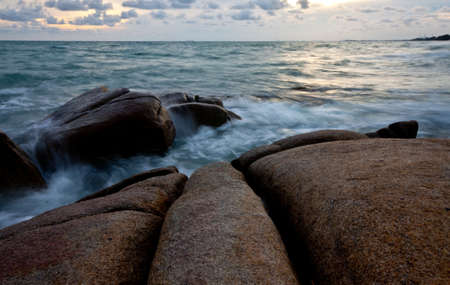 stone and waves during sundown  Natural composition Stock Photo - 16257706