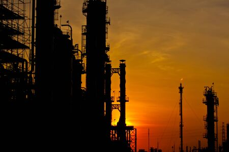 petrochemical plant in silhouette image at sun set photo
