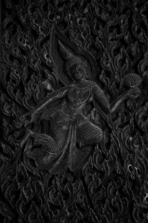 thai angle wood carving,generality in thailand,any kind of art decorated in buddhist church,temple pavillion temple hall etc they are public domain or treasure of buddhism,no restrict in coppy or use  photo