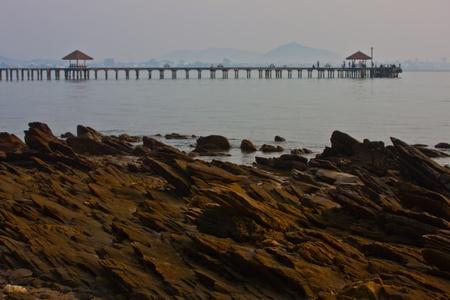dunquin: a stone beach in bridge background