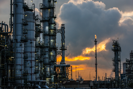 petrochemical: petrochemical plant in sunset Stock Photo
