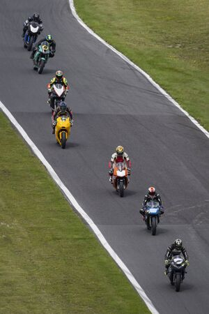 Multiple racing bikes on a track