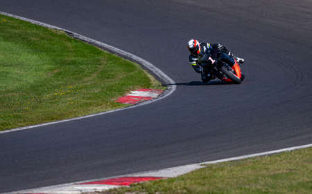 A shot of a racing bike cornering on a track.