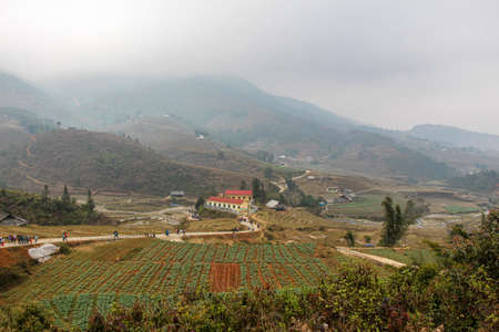A view across a valley of rice terraces and agricultural land in Sapa, Northern Vietnam