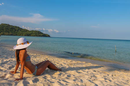 A female asian model relaxing in the sun on the tropical Sao Beach, Phu Quoc, Vietnam