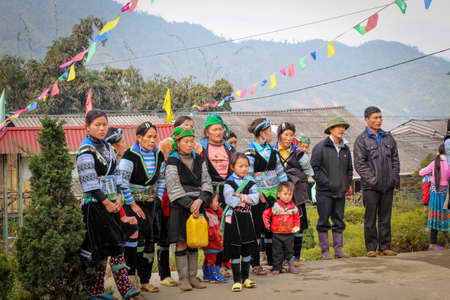 Sapa, Vietnam - January 16th 2014: Hmong tribe on a cold winters morning in Sapa, Vietnam Editorial