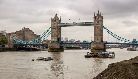 The historic Tower Bridge on the River Thames on a cloudy day in summer in the centre London, England